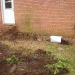 lackluster backyard in need of backyard hardscape designs
