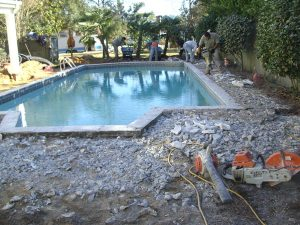 demo before new hardscape is installed around pool