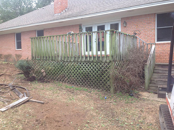 unstable wooden deck will be replaced with backyard hardscape