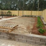 placing retaining wall