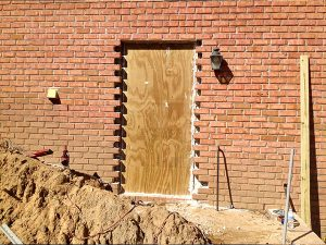 new door was knocked out during backyard hardscape designs