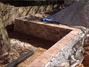 retaining wall installed during backyard hardscape